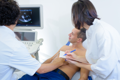 medical professionals checking the health condition of male patient using ultrasound