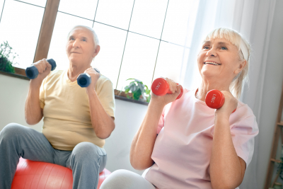 two seniors doing exercise