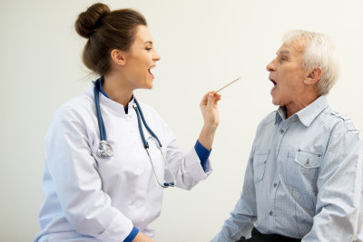 female doctor checking senior man